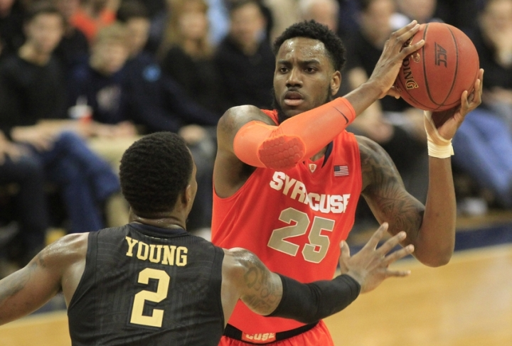 Feb 7, 2015; Pittsburgh, PA, USA; Syracuse Orange forward Rakeem Christmas (25) handles the ball as Pittsburgh Panthers forward Michael Young (2) defends during the second half at the Petersen Events Center. Pittsburgh won 83-77. Mandatory Credit: Charles LeClaire-USA TODAY Sports