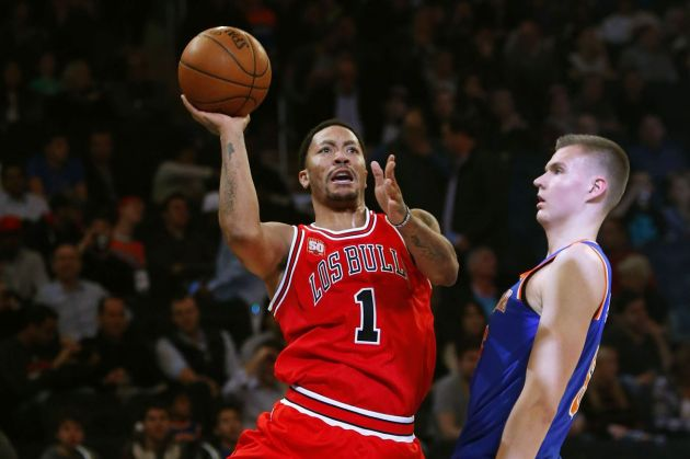Derrick Rose pictured with his new teammate, Kristaps Porzingis. (Noah K. Murray/USA TODAy Sports)